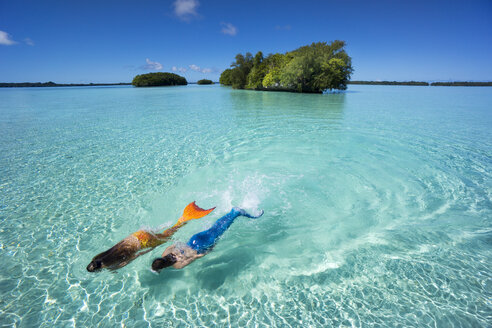 Palau, two young women in mermaid costume swimming in a lagoon - JWAF000103