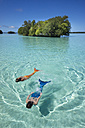 Palau, two young women in mermaid costume swimming in a lagoon - JWAF000107
