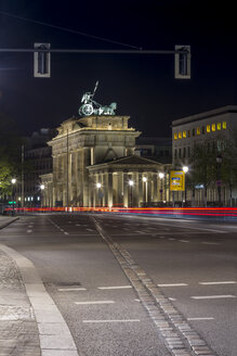 Germany, Berlin, Brandenburger Tor at night, the cobblestone line marks the former position of the Berlin Wall - NKF000149