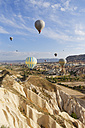 Turkey, Cappadocia, hot air balloons hoovering over tuff rock formations at Goereme National Park - SIEF005529