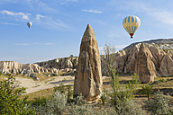 Turkey, Cappadocia, two hot air balloons hoovering over tuff rock formations at Goereme National Park - SIEF005531