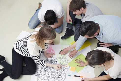 Group of creative professionals working on floor - STKF001006