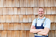 Confident craftsman at wooden wall - FKCF000002