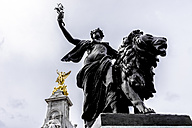 United Kingdom, England, London, Westminster, Victoria Monument, Statues of Queen Victoria and Goddess of Victory and Statue of a woman with lion in the foreground - WEF000180