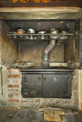 New Zealand, South Island, Tasman, Kahurangi Point, old iron wood stove with pots in the old lightkeepers hut - SH001519