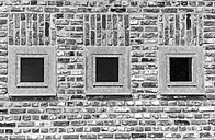 Germany, North Rhine-Westphalia, Grevenbroich, part of brick facade with three windows - HLF000626