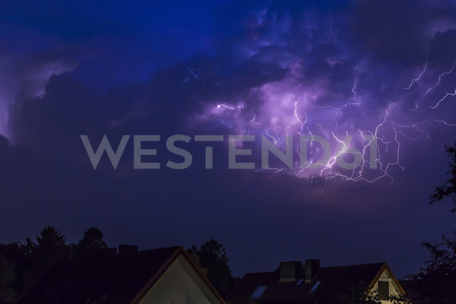 Germany, Hamburg, dramatic night sky at heavy thunderstorm - NK000167