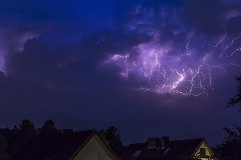 Germany, Hamburg, dramatic night sky at heavy thunderstorm - NK000167