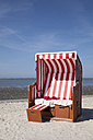 Germany, Lower Saxony, Dornum, Nessmersiel, red and white hooded beach chair - WIF000875