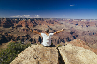 USA, Arizona, man enjoying the view at Grand Canyon, back view - MBEF001081