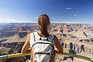 USA, Arizona, young woman enjoying the view at Grand Canyon, back view - MBEF001084