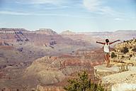 USA, Arizona, woman enjoying the view at Grand Canyon, back view - MBEF001088