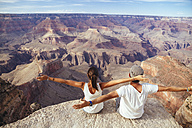USA, Arizona, couple enjoying the view at Grand Canyon, back view - MBEF001091