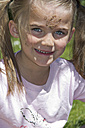 Portrait of smiling little girl with sand in her face - YFF000196