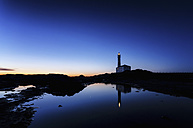 Spain, Balearic Islands, Menorca, Cap de Cavalleria, lighthouse at sunrise - SMAF000221