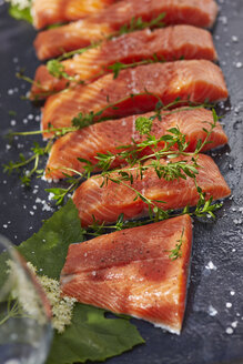 Germany, Pieces of salmon filet, Thyme and elderflowers - AKF000396