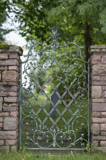 Germany, Bavaria, Rottach-Egern, wrought-iron garden gate - HLF000620