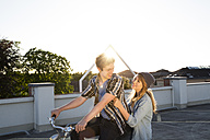 Happy teenage couple outdoors on bicycle - FKF000573