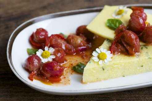 Platter of herbed polenta with vegan cheese, gooseberries and chili relish - HAWF000375