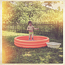 Germany, Rhineland-Palatinate, Kaiserslautern, little girl with paddling pool - LVF001541