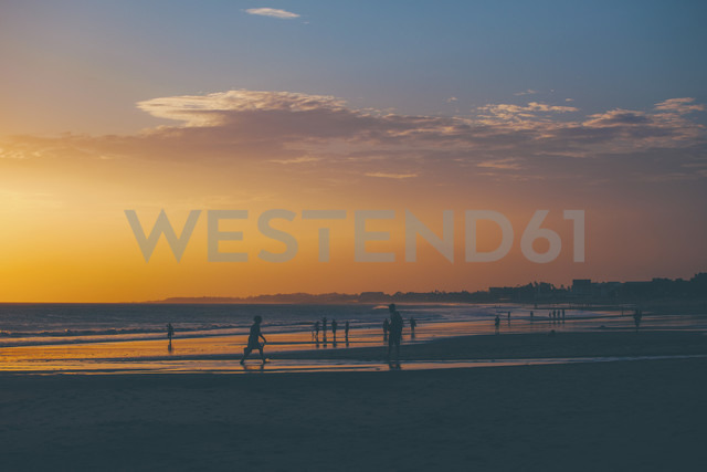 Indonesia, Bali, people relaxing on the beach at sunset - EBS000250