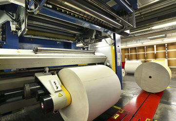 Presses with rolls of paper in a printing shop - SCH000363