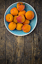 Bowl of apricots on wood, elevated view - LVF001540