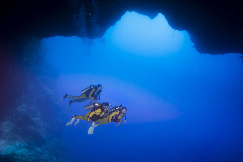 Palau, Pacific Ocean, two scuba divers in underwater cave - JWAF000160