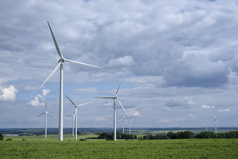 Germany, Saxony, Wind turbines on field - ELF001163