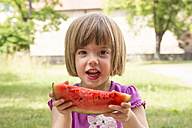 Portrait of little girl eating watermelon - LVF001569