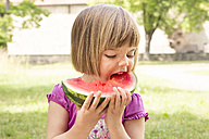 Portrait of little girl eating watermelon - LVF001570
