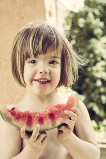 Germany, Young girl with water melon - LVF001583