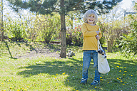Boy carrying Jack Russel Terrier puppy in bag - MJF001326