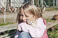 Happy girl hugging kitten - HHF004833