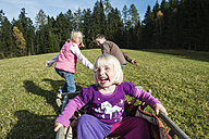 Three children playing on meadow - HHF004838