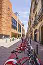 Spain, Barcelona, Sant Pere, rental bike station - THA000544