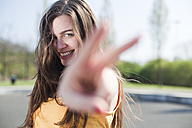Portrait of happy young woman outdoors - FEXF000109