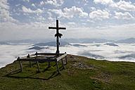 Austria, Tyrol, Chiemgau Alps, Summit cross at Fellhorn mountain - LBF000845