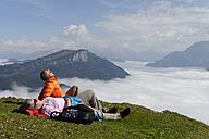 Austria, Tyrol, Chiemgau Alps, Hikers resting at Fellhorn mountain - LBF000854