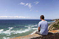 Portugal, Sintra, man looking to the ocean - FAF000018