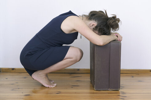 Frustrated woman with suitcase - MW000059