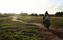 Indonesia, Bali, Nusa Lembongan, two persons driving on a scooter - FAF000045