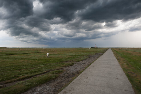 Germany, Schleswig-Holstein, North Sea, Thunderstorm over the Lighthouse Westerheversand - RJ000215