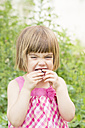 Portrait of little girl eating cherry - LVF001673