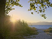 Spain, Galicia, Province of A Coruna, Porto do Son, Beach against the sun - LAF001073