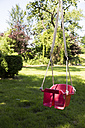 Children's swing in a garden - TKF000367