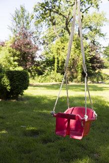 Children's swing in a garden - TKF000367