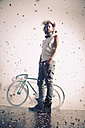 Young man with racing bicycle and confetti in the air - VEF000005