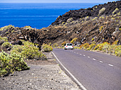 Spain, Canary Islands, La Palma, Faro de Fuencaliente, Country road and car - AMF002583