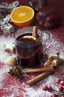 Glass of mulled wine with slice of orange and cinnamon stick - CSF022005